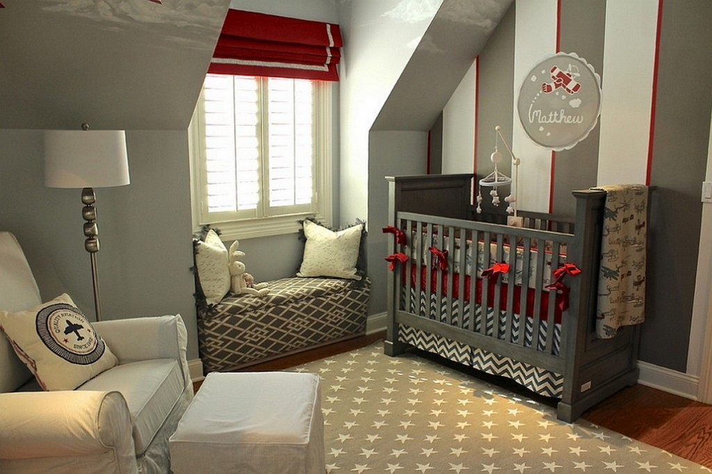 modern-grey-nursery-room-with-red-accent-on-the-wall-paper-drapes-and-sheet-also-stars-patterned-rug-and-cozy-window-seating